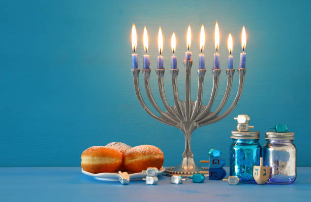 image of jewish holiday hanukkah background with menorah (traditional candelabra) and candles. - hanukkah stock pictures, royalty-free photos & images