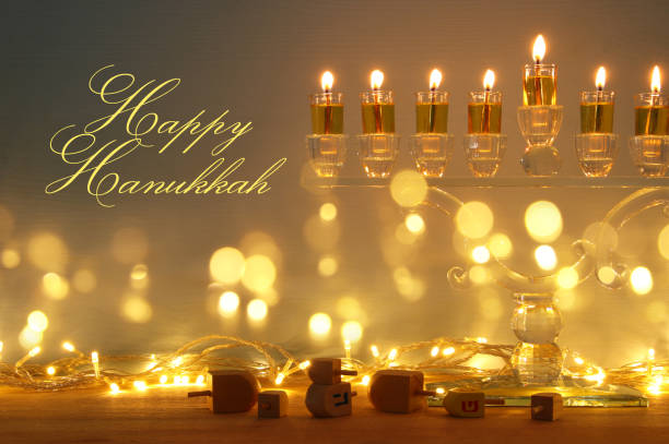 image of jewish holiday Hanukkah background with menorah (traditional candelabra) and candles. stock photo