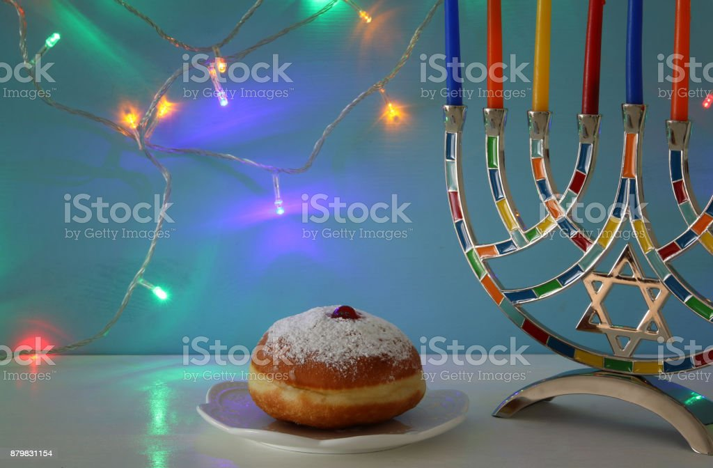 image of jewish holiday Hanukkah background with menorah and candles