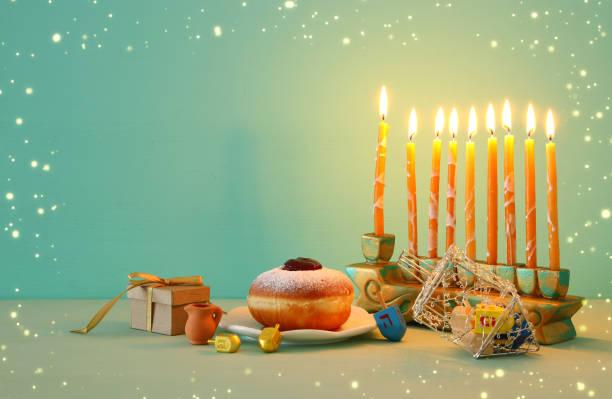 image of jewish holiday Hanukkah background with menorah (traditional candelabra). stock photo