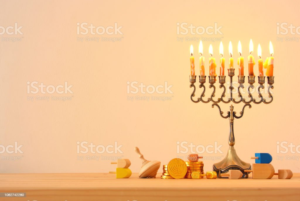Image of jewish holiday Hanukkah background with traditional spinnig...