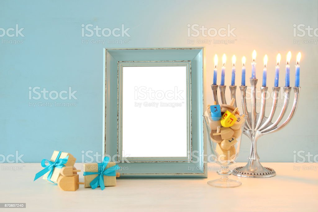 image of jewish holiday Hanukkah background with traditional spinnig top, menorah (traditional candelabra) stock photo