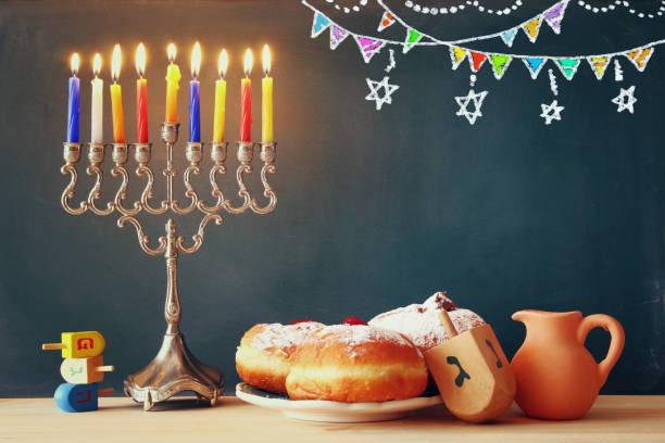 image of jewish holiday hanukkah with menorah - hanukkah stock pictures, royalty-free photos & images