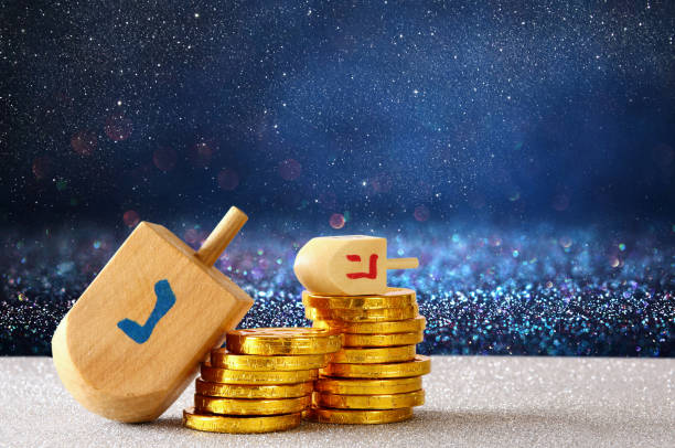 Image of jewish holiday Hanukkah with wooden dreidel stock photo