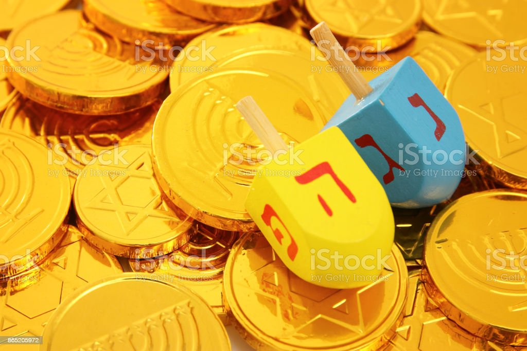 Image of jewish holiday Hanukkah with wooden dreidels and gold...