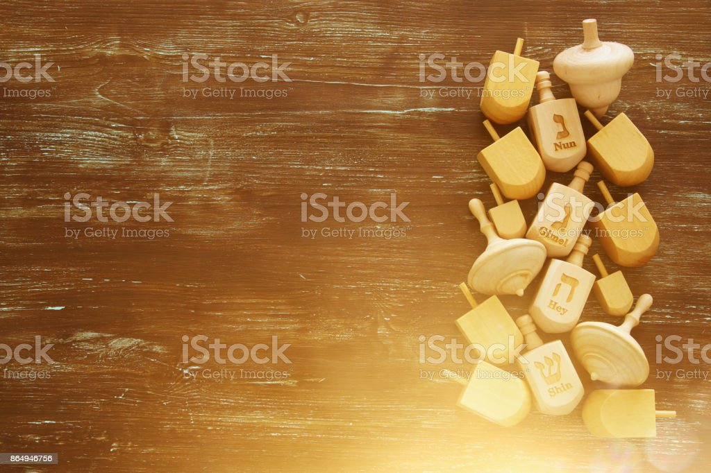 Image of jewish holiday Hanukkah with wooden dreidels colection on...