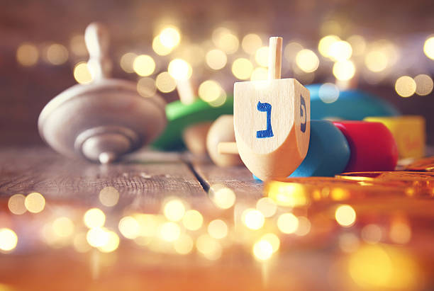 image of jewish holiday hanukkah with wooden dreidels - chanukka stock-fotos und bilder