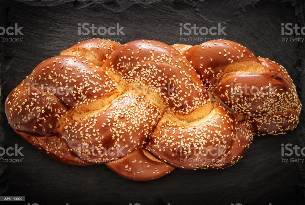 Image of jewish traditional challah bread on slate stone plate stock photo