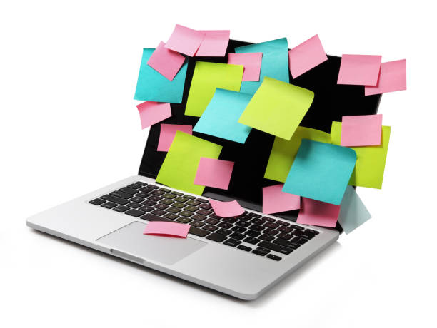 image of laptop full of colorful sticky notes reminders on screen isolated on white. work overload concept image - to do list foto e immagini stock