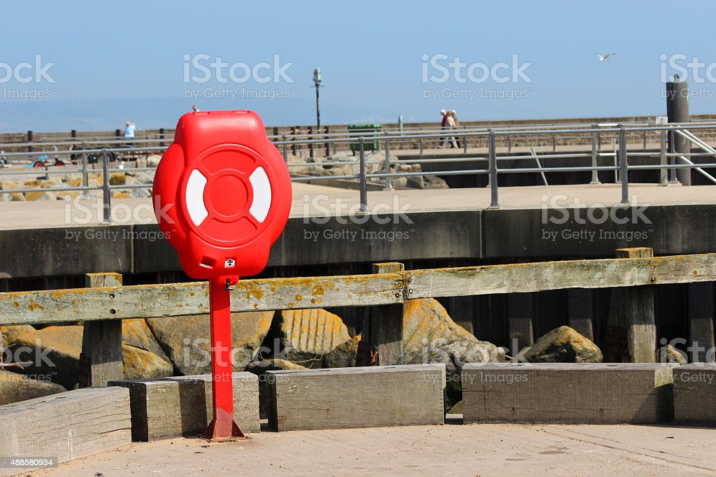 Image of life preserver lifering / life-buoy donut by seafront harbour stock photo
