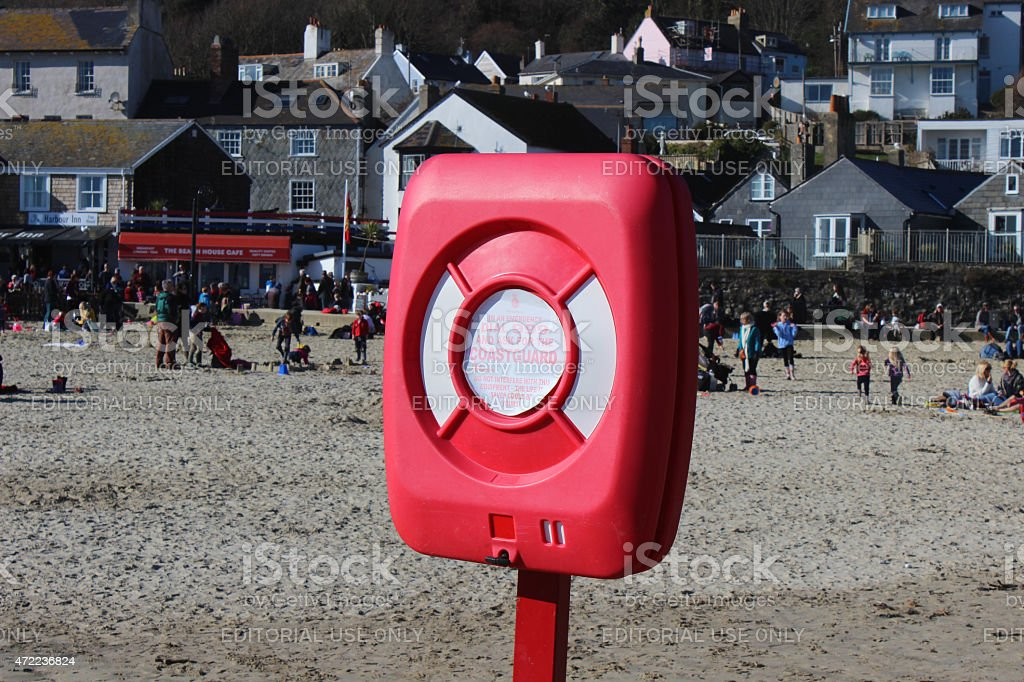 Image of lifering buoyancy aid on beach, by sea, for-emergencies stock photo
