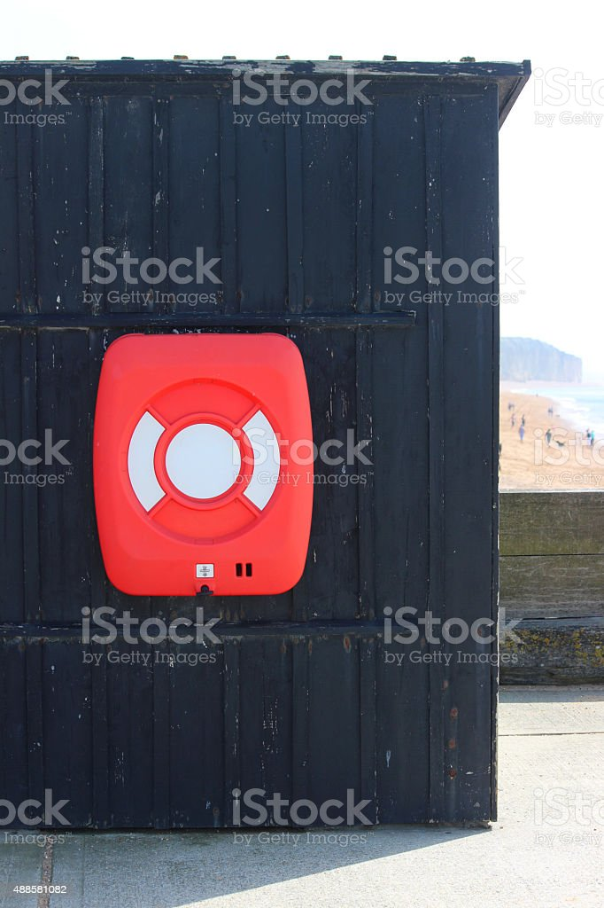 Image of lifering ring buoy / lifering lifesaver donut by beach stock photo