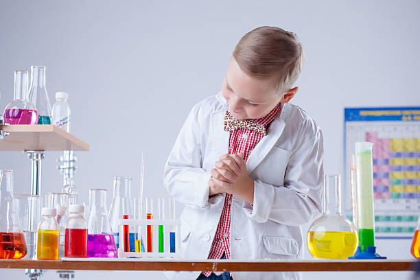 image of little scientist posing with reagents - young nudist boys stock photos and pictures