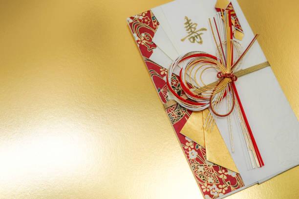 image of luxurious your gift envelopes - мидзухики стоковые фото и изображения