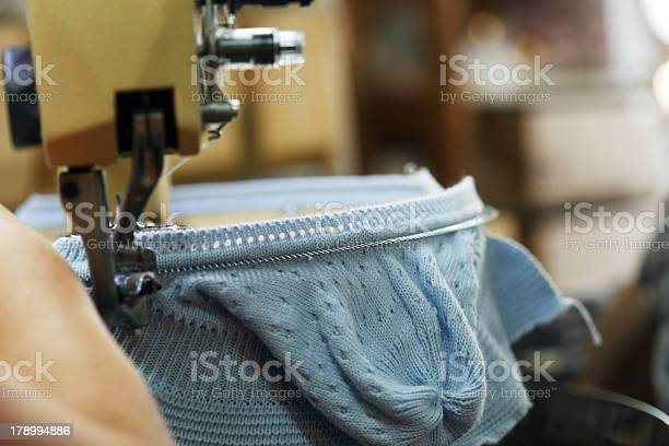 Image Of Machine Knitting Blue Childrens Cap Stock Photo - Download Image Now
