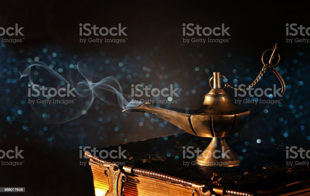 Image of magical aladdin lamp with glitter smoke. Lamp of wishes stock photo