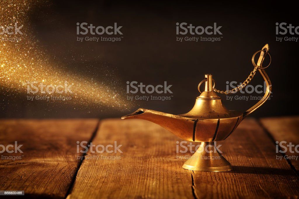 Image of magical aladdin lamp with glitter smoke. Lamp of wishes. stock photo