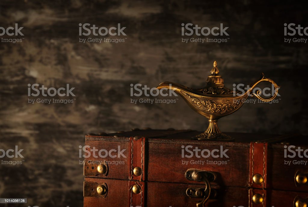 Image of magical mysterious aladdin lamp over black background. Lamp of wishes. стоковое фото