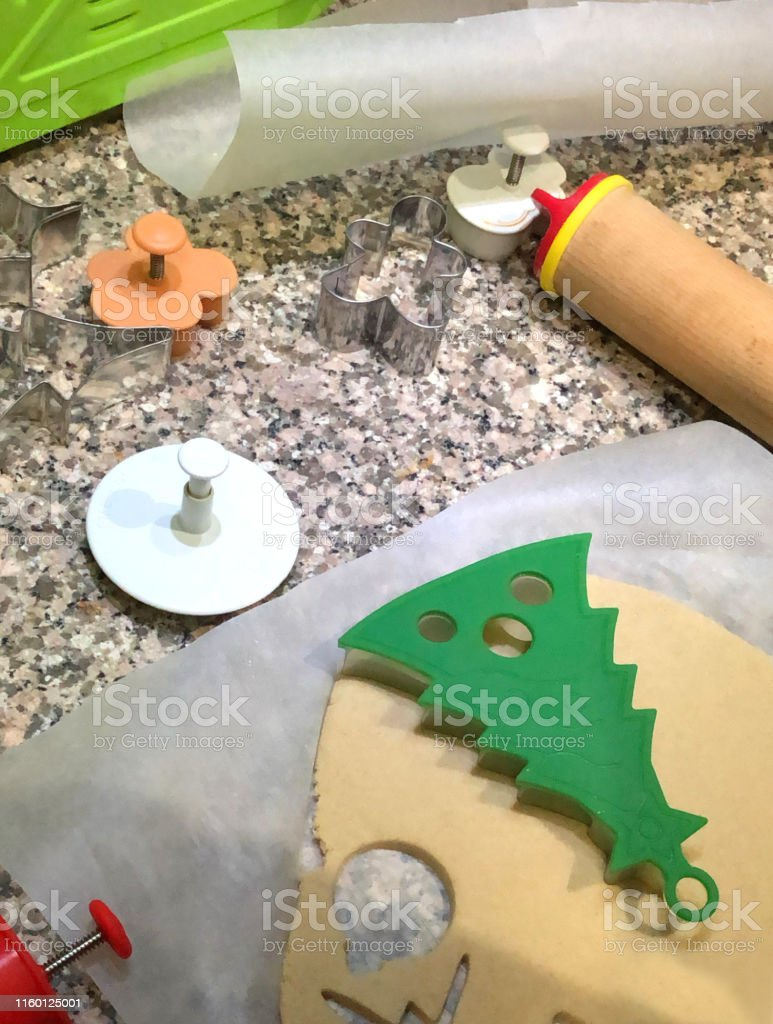 Image Of Making Christmas Cookies In Kitchen Using Cookie
