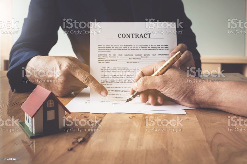 Image of Man's notary public hand pointing at the contract. business man, law attorney, lawyer notary public, bank manager concept. stock photo
