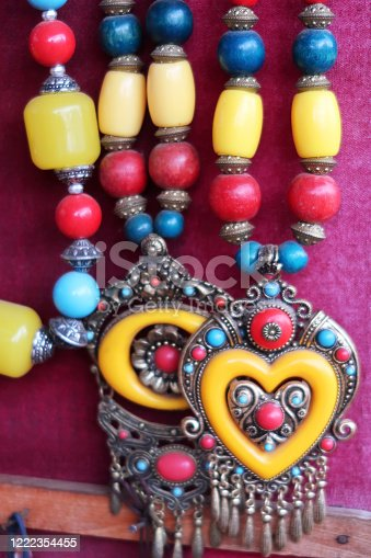 Stock photo showing a collection of  Indian-style necklaces ready for sale at a market stall.