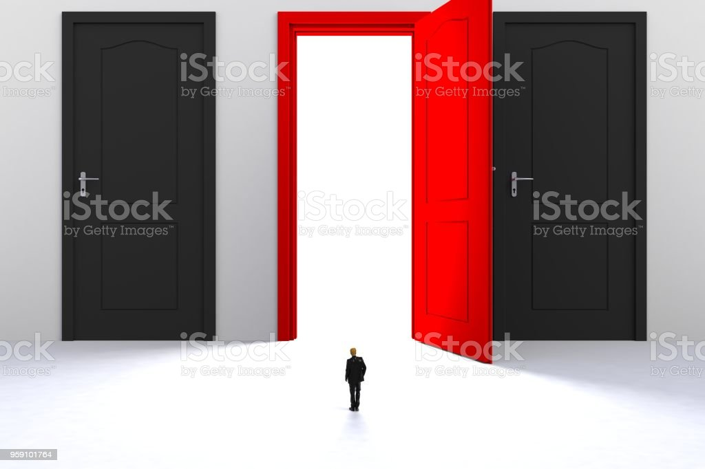 Image of miniature businessman standing in front of open red door on white wall background. stock photo