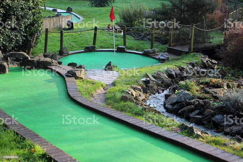 Image of miniature golf course (crazy golf), putting greens / flags stock photo