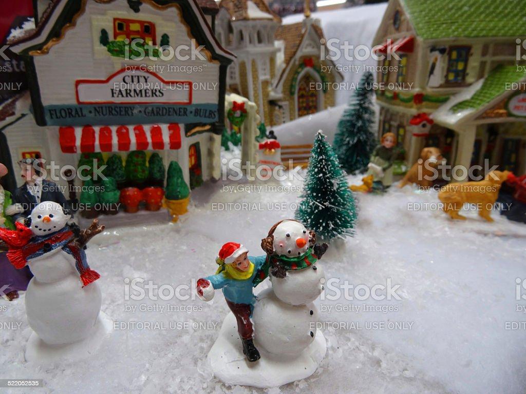 Image of model Christmas village , miniature houses, people, snowmen stock photo