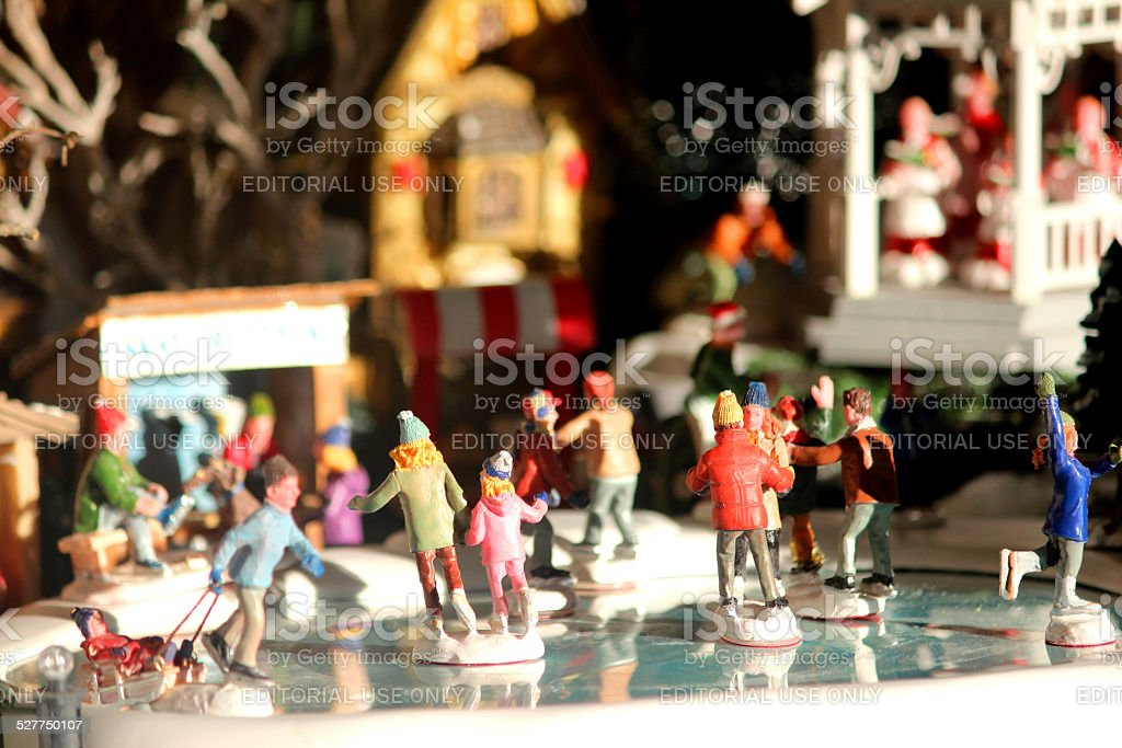 Image of model Christmas village with iceskating rink, people, winter-scene stock photo