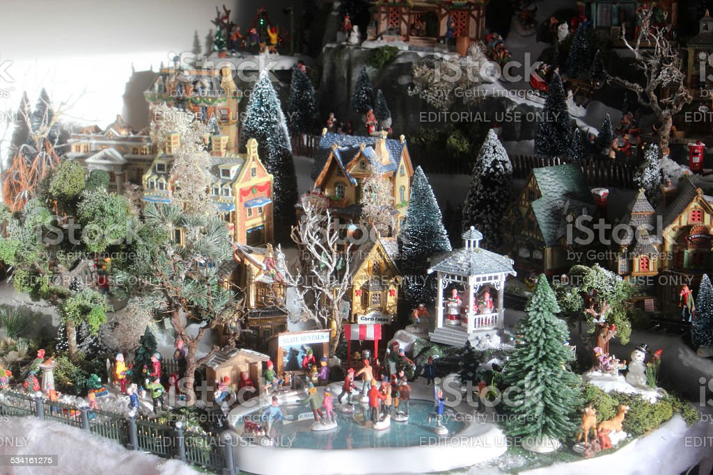 Image of model Christmas village with miniature houses, people, ice-skating stock photo