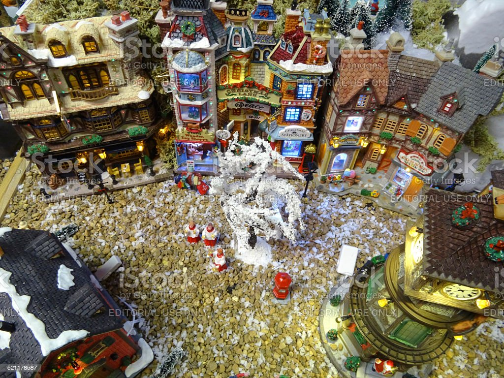 Image of model Christmas village with miniature houses, people, Santa stock photo