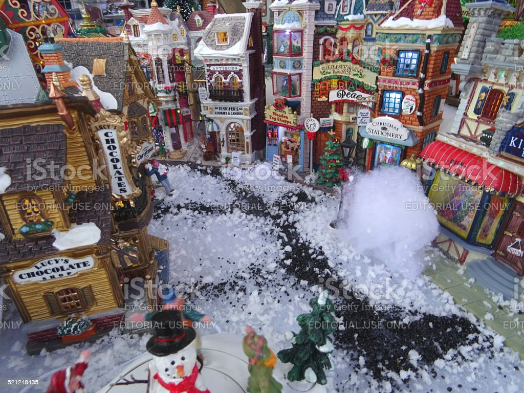 Image of model Christmas village with miniature houses, people, snowman stock photo