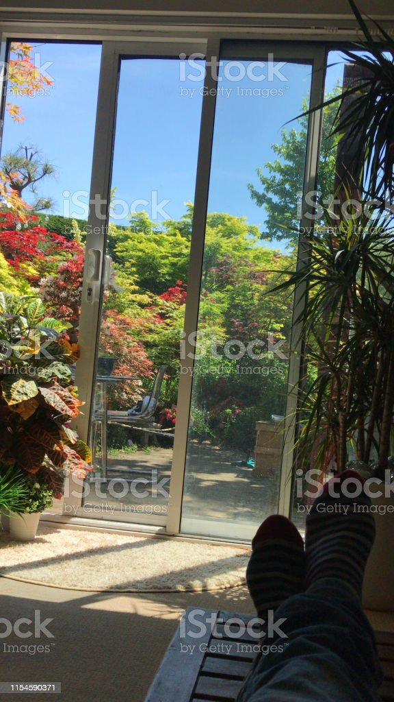 Stock photo of modern home interior design sunny lounge double doors...