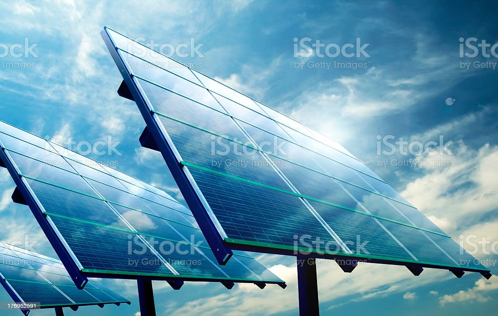 Image of multiple solar cells reflecting sunlight stock photo