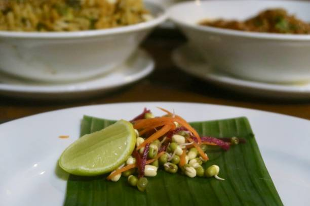 image of mung bean, carrot and beetroot healthy appetiser served on white plate with banana leaf - appetiser stock photos and pictures