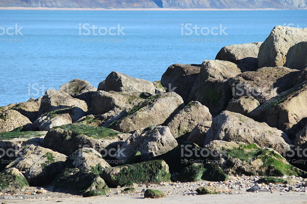 Image of natural sea defence, rock armour on-beach, coastal management stock photo