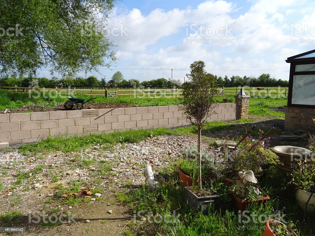 Image Of New Concrete Block Garden Wall, Backyard Landscaping Project  Royalty Free Stock Photo