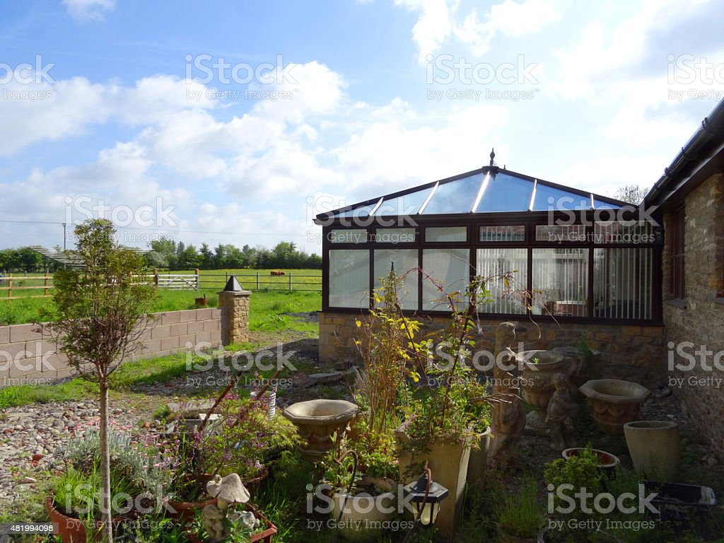 Image of newly built square conservatory with glass pyramid roof stock photo