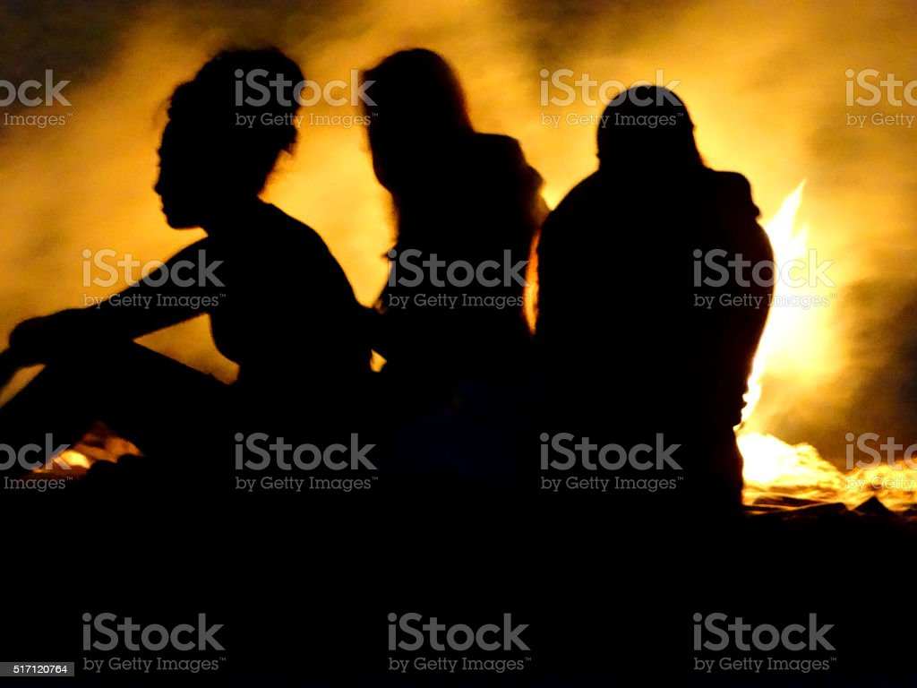 Photo showing silhouetted outlines of female figures backlit by a...