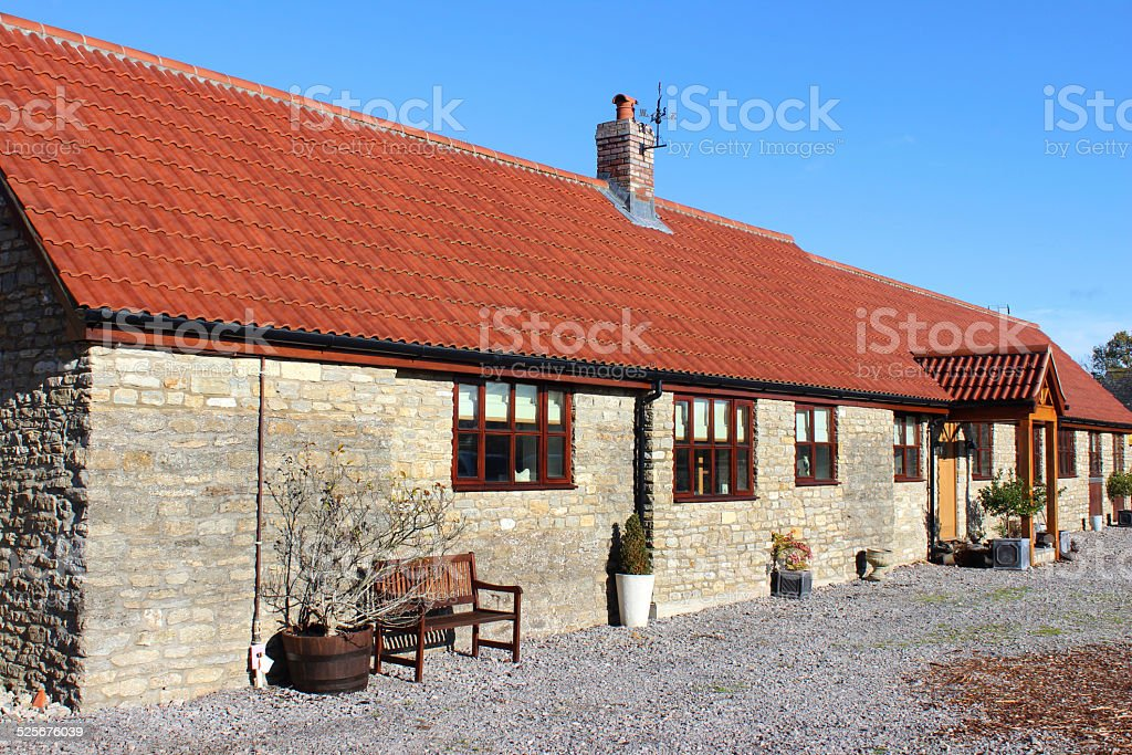 Image of old barn conversion house / bungalow, converted stables / outbuilding stock photo