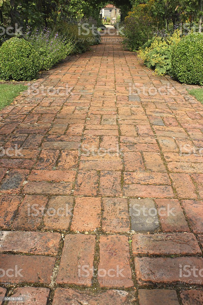Image of old red brick path, block paving, paved pathway stock photo