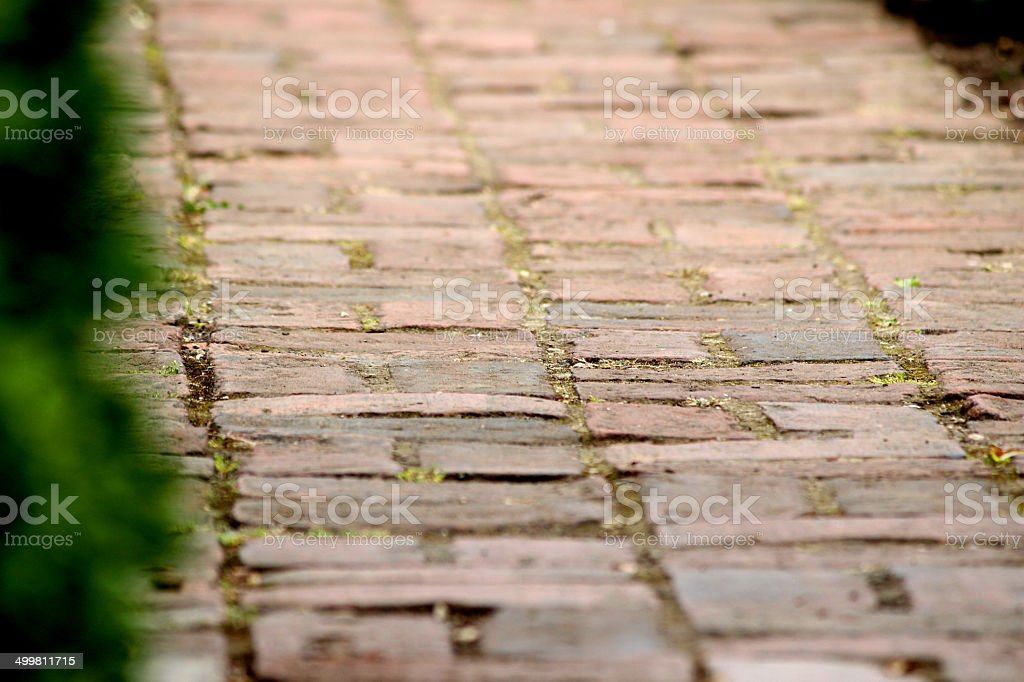 Image of old red brick pathway / block paved garden path stock photo