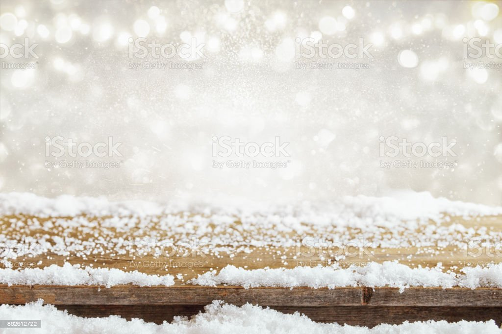 Image of old wooden table in front of glitter lights background. De-focused. Ready for product display montage stock photo