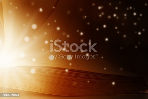 528389419istockphoto Image of opened magic book with star lights 836405360