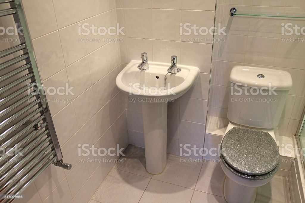 Image Of Pedestal Sink, Chrome Radiator, Modern, White Tiled Bathroom  Royalty Free