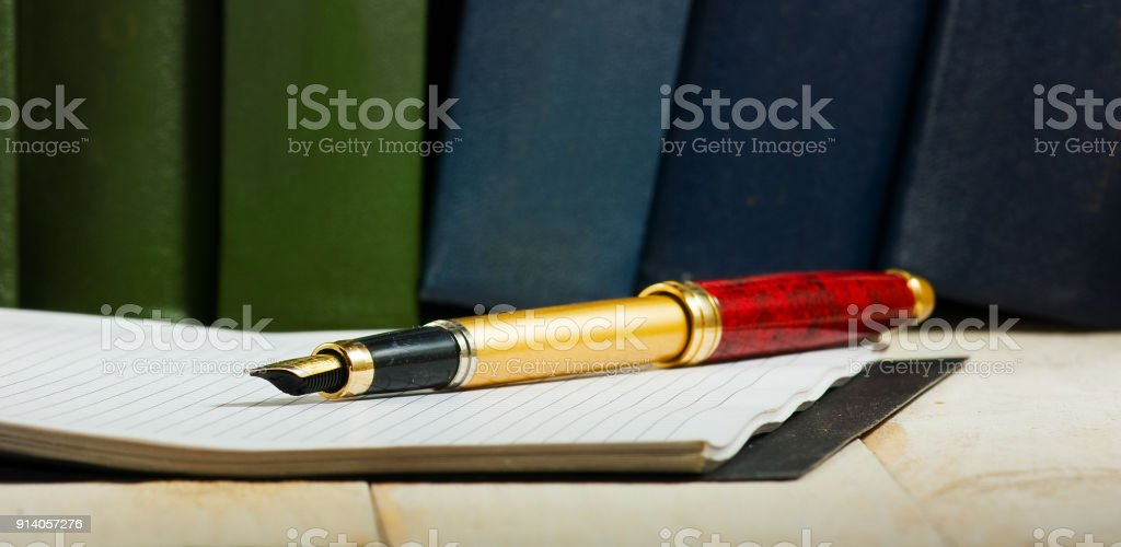 Image of pen and notebook close up stock photo