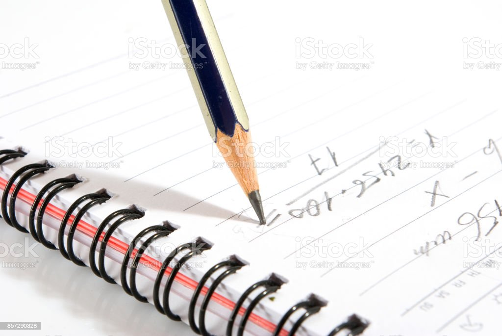 image of pencil and notebook close-up stock photo