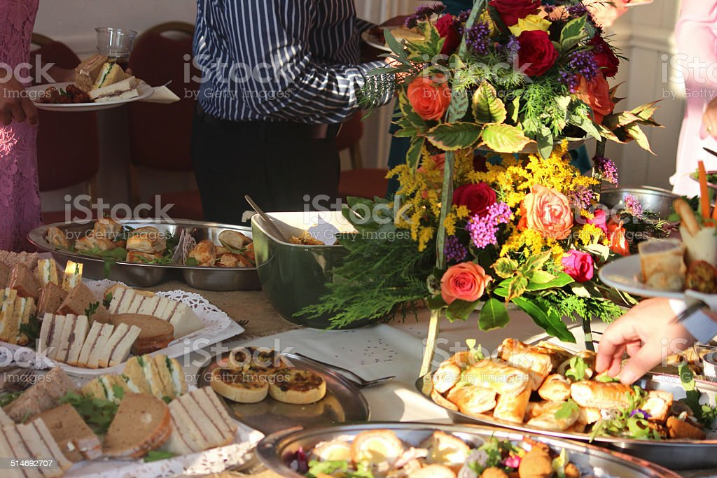 Image of people serving themselves buffet table party food image of people serving themselves buffet table party food flower display royalty watchthetrailerfo