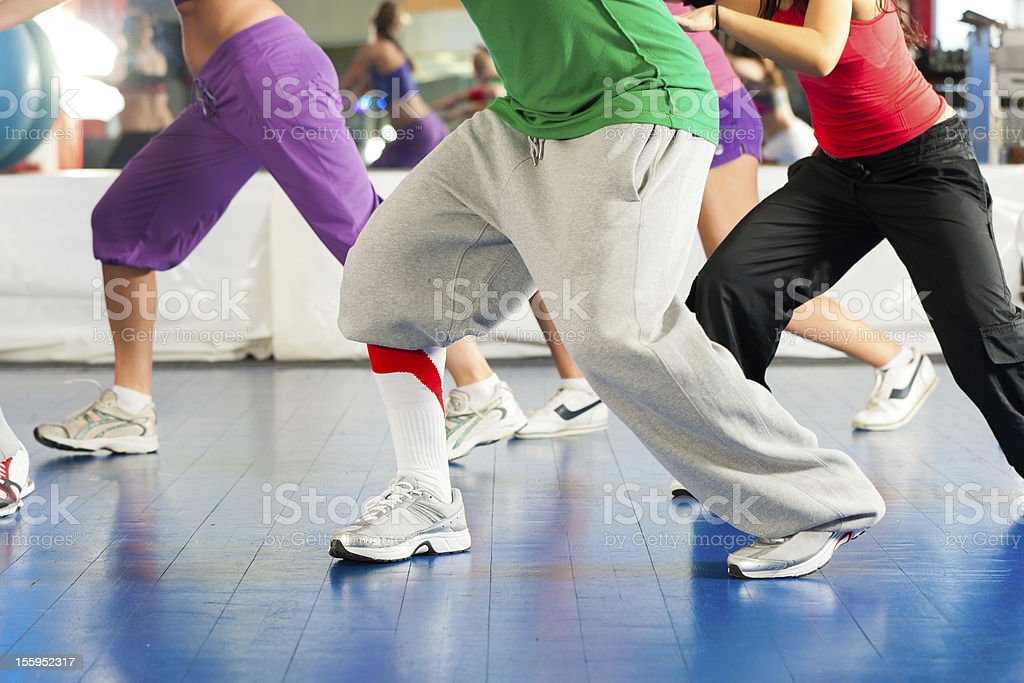 Image of people's legs in dance class at gym royalty-free stock photo
