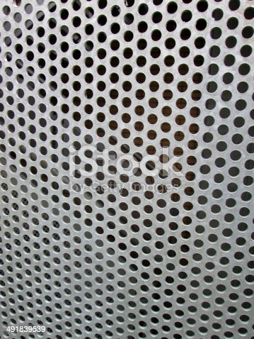 istock Image of perforated metal sheet with holes forming geometric pattern 491839539